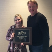 Erin MacDonald-Birnbaum Receiving Career Achievement Award from CEO Dan Smith, April 9, 2016