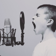 Frequently asked questions about book publicity. A child screaming into a microphone to convey the different ways to publicize your book.