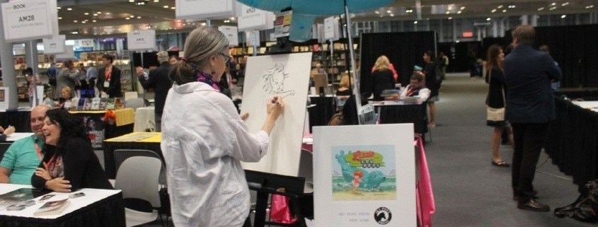 Authors display their books at the 2019 BookExpo and BookCon