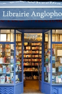 A local bookstore where authors can plan a book signing event. Author signing books in a bookstore.
