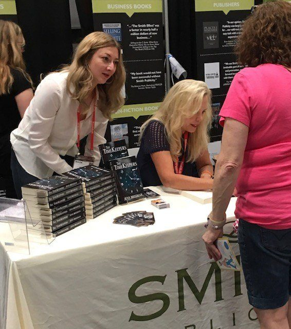 Sarah Miniaci managing client book signing, BookExpo 2018. Smith Publicity client author at a book signing event at bookexpo.